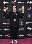 Founding member of KISS and breast cancer survivor Peter Criss poses on the PINK carpet at Hard Rock Cafe New York to launch PINKTOBER, Hard Rock's 15th annual breast cancer awareness campaign, benefitting The Breast Cancer Research Foundation, Tuesday, Sept. 30, 2014.  (Photo by Diane Bondareff/Invision for Hard Rock International/AP Images)