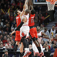 24 March 2012: Toronto Raptors center Andrea Bargnani (7), Chicago Bulls power forward Carlos Boozer (5) and Toronto Raptors power forward Amir Johnson (15) vies for the rebound during the Chicago Bulls 102-101 victory in overtime over the Toronto Raptors at the United Center, Chicago, Illinois, USA.