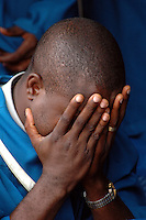 GHANA,Accra,Adabraka, 2007. A choir member takes a moment during Sunday's services at the Calvary Baptist Church in Adabraka.