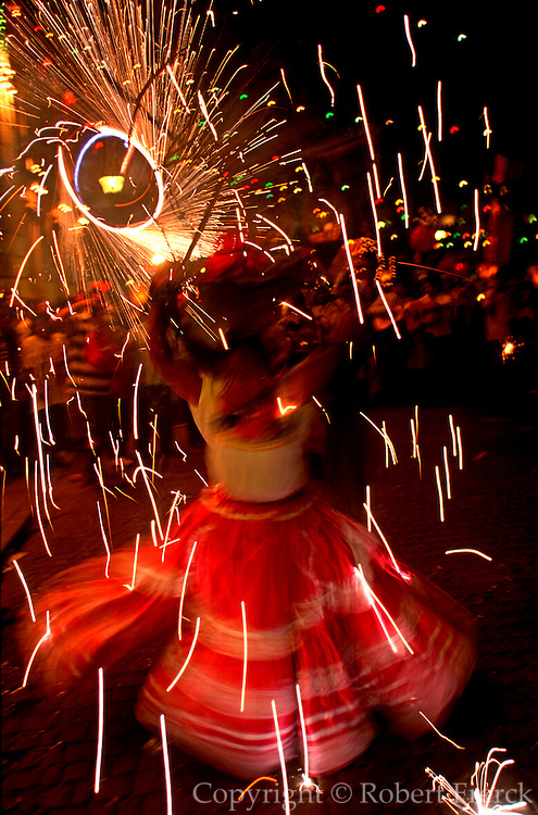 MEXICO, OAXACA, FESTIVALS Christmas, women with fireworks