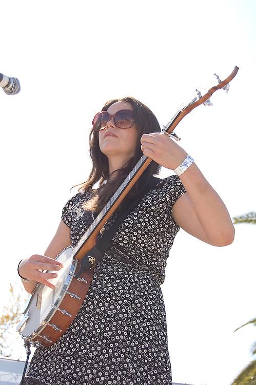 Gabrielle Pietrangelo plays banjo during the Silver Thread Trio concert at Fiesta en el Barrio Viejo 2010, Tucson, Arizona. The all-day concert is now known as Fiesta en el Barrio. Event photography by Martha Retallick.