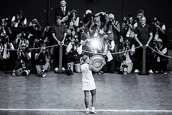 Angelique Kerber kisses the trophy after winning the Ladies' Singles Final against Serena Williams on day twelve of the Wimbledon Championships at the All England Lawn Tennis and Croquet Club, Wimbledon.