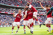 Arsenal midfielder Granit Xhaka (29), Arsenal forward Lacazette (9), Arsenal forward Olivier Giroud (12), Arsenal midfielder Mohamed Elneny (35)  celebrate win  the FA Community Shield match between Arsenal and Chelsea at Wembley Stadium, London, England on 6 August 2017. Photo by Sebastian Frej.