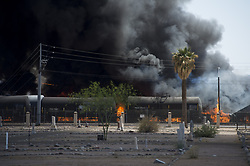 April 27, 2018 - Phoenix, Arizona, U.S - Firefighters work the scene of a fire at a recycling plant near 13th Avenue and Harrison Street in Phoenix, Arizona. (Credit Image: © Ben Moffat/via ZUMA Wire via ZUMA Wire)