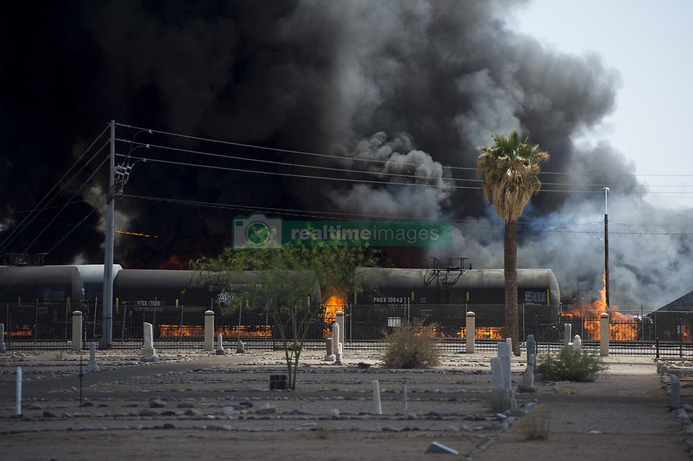 April 27, 2018 - Phoenix, Arizona, U.S - Firefighters work the scene of a fire at a recycling plant near 13th Avenue and Harrison Street in Phoenix, Arizona. (Credit Image: © Ben Moffat/via ZUMA Wire via ZUMA Wire)
