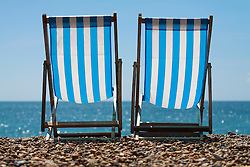 Brighton, UK. Deckchairs on Brighton Beach. Photo Credit: Hugo Michiels