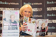 """TV cook Mary Berry signs copies of her new book """"Mary Berry Cooks the Perfect"""" at Selfridges department store, London."""