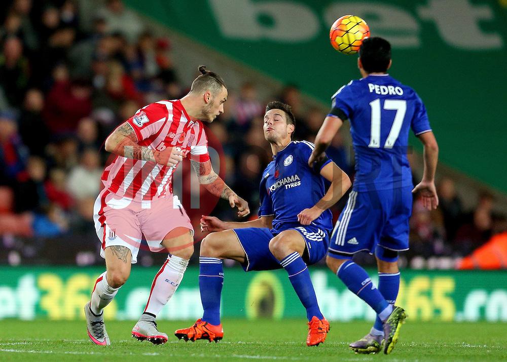 Marko Arnautovic of Stoke City heads the ball over Cesar Azpilicueta of Chelsea  - Mandatory byline: Matt McNulty/JMP - 07966 386802 - 07/11/2015 - FOOTBALL - Britannia Stadium - Stoke-On-Trent, England - Stoke City v Chelsea - Barclays Premier League