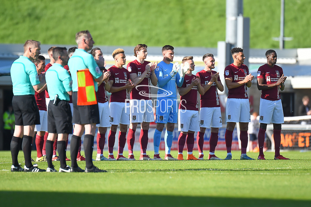 The Northampton Town players and officials applaud the fans who are no longer with us during the EFL Sky Bet League 1 match between Northampton Town and Oldham Athletic at Sixfields Stadium, Northampton, England on 5 May 2018. Picture by Dennis Goodwin.