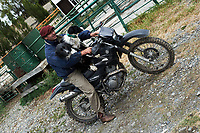 Gaucho Sheepherder in Patagonia About to Take His Sheep Dogs on a Yamaha Motorcycle to Roundup Some Sheep. The image was taken with a Nikon D3s and 50 mm f/1.4G lens (ISO 200, 50 mm, f/8, 1/320 sec).