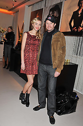 NOELLE RENO and SCOT YOUNG at the unveiling of the Helena Christensen and Swarovski Crystallized Unsigned Model search winners held at Swarovski Crystallized, 24 Great Marlborough Street, London on 26th January 2012.