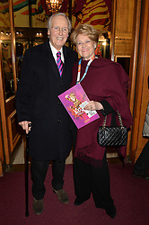 NICHOLAS PARSONS and his wife ANNIE at the Cirque Du Soleil's VIP performance of Kooza at The Royal Albert Hall, London on 6th January 2015.