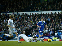Photo: Andrew Unwin.<br />Leeds United v Cardiff City. Coca Cola Championship.<br />10/12/2005.<br />Leeds' Sean Gregan (C) brings down Cardiff's Jason Koumas. He received a yellow card and Cardiff scored from the resulting free-kick.