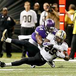 Sep 21, 2014; New Orleans, LA, USA; New Orleans Saints running back Khiry Robinson (29) is tackled by Minnesota Vikings middle linebacker Jasper Brinkley (54) during the second half of a game at Mercedes-Benz Superdome. The Saints defeated the Vikings 20-9. Mandatory Credit: Derick E. Hingle-USA TODAY Sports