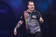 Kim Huybrechts hits a double and wins a leg during the PDC William Hill Darts World Championship at Alexandra Palace, London, United Kingdom on 13 December 2019.