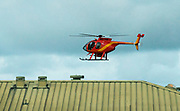 A Hawaiian Fire helicopter readies to land on the grounds of the Pahoa Police and Fire Stations as the Kilauea lower east rift zone eruption continues on Wednesday, June 6, 2018, in Pahoa, Hawaii. Photo by L.E. Baskow/LeftEyeImages