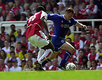 Foto: Peter Spurrier, Digitalsport<br /> NORWAY ONLY<br /> <br /> 15/05/2004  - 2003/04 Premiership Football - Arsenal v Leicester City<br /> <br /> Paul Dickov tries to get around Kolo Toure.