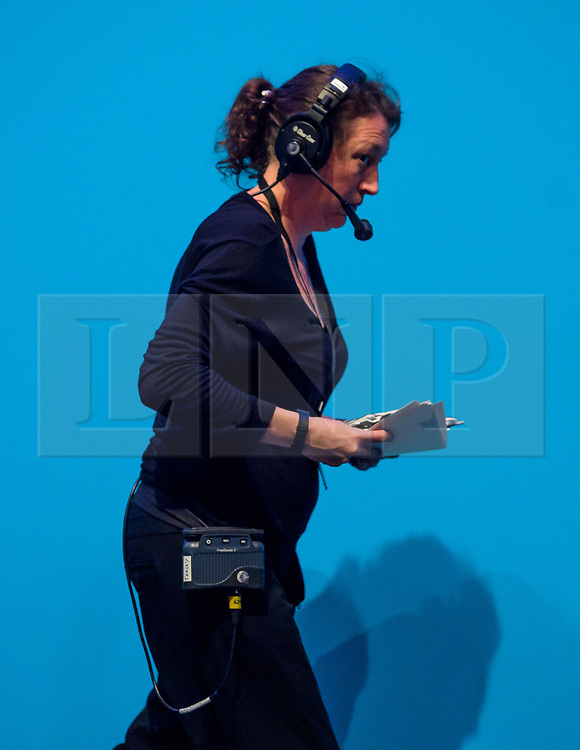 "© Licensed to London News Pictures. 04/10/2017. Manchester, UK. A producer carrying letters removed got the stage that were spelling out the conservative slogan ""BUILDING A COUNTRY THAT WORKS FOR EVERYONE"". The letter began falling off during the speech.  British prime minister THERESA MAY delivers her leaders speech on the final day of the Conservative Party Conference. The four day event is expected to focus heavily on Brexit, with the British prime minister hoping to dampen rumours of a leadership challenge. Photo credit: Ben Cawthra/LNP"