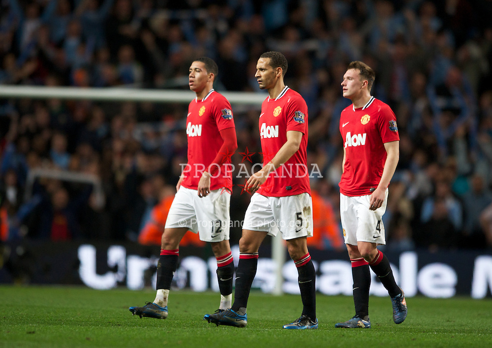 MANCHESTER, ENGLAND - Monday, April 30, 2012: Manchester United's Chris Smalling, Rio Ferdinand and Phil Jones look dejected at full-time following the Premiership match at the City of Manchester Stadium. (Pic by Chris Brunskill/Propaganda)