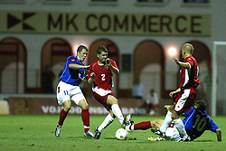 NOVI SAD, SERBIA -Tuesday, August 19th, 2003: Wales' Michael Moss is tackled by Serbia & Montenegro's Milos Maric in action against Serbia & Montenegro during the UEFA Under 21 European Championship Group 9 Qualifying match at the Karadorde Stadium. (Pic by David Rawcliffe/Propaganda)