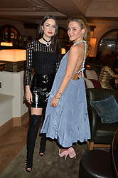 Left to right, EMMA MILLER and AMBER ATHERTON at the unveiling of a Very Special Malone Souliers Christmas Tree, In Support Of Starlight Children's Foundation held at The Club Cafe Royal, Regent Street, London on 2nd December 2015.