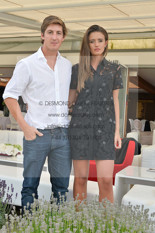 GEORGE MEYRICK and ISABELLA O'DUFFY at the Audi International Polo at Guards Polo Club, Windsor Great Park, Egham, Surrey on 26th July 2014.