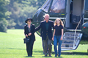 WASHINGTON, DC - September 1: President Bill Clinton with Chelsea and Hillary arrives back from vacation in Martha's Vineyard on Marine One in Washington, DC. September 1, 1997  (Photo RIchard Ellis)