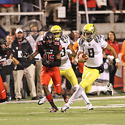 University of Oregon Ducks' QB Marcus Mariota broke for 61 yards on the first play of the Ducks first possesion vs the University of Utah Utes at Rice-Eccles Stadium, Salt Lake City, Utah. Photo by Barry Markowitz, 11/8/14, 3pm