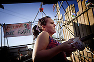 UNITED KINGDOM, Basildon :Residents sit on barricades next to the main gate at Dale Farm travellers camp on September 19, 2011 in Basildon, England.  © Christian Minelli.