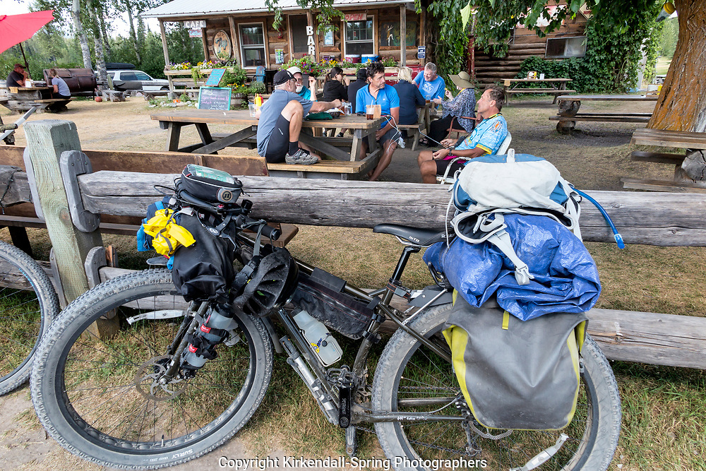 BC00644-00...MONTANA - Crew ridding the Great Divide Mountain Bike Route take a break in Polbridge.