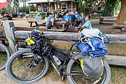 BC00644-00...MONTANA - Crew ridding the Great Divide Mountain Bike Route take a break in Polbridge.