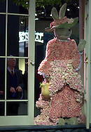 """An unidentified man views a bunny rabbit made from flowers, at a preview of the Philadelphia Flower Show, Saturday, March 2, 2002, in Philadelphia, Pa. The Philadelphia Flower Show runs from March 3-10, and is the largest indoor flower show in the world. This years theme is """"The Pleasures of the Garden."""" (Photo by William Thomas Cain/photodx.com"""