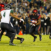 24 November 2018: San Diego State Aztecs running back Juwan Washington (29) rushes the ball in the second quarter. The Aztecs closed out the season with a 31-30 overtime loss to Hawaii at SDCCU Stadium.