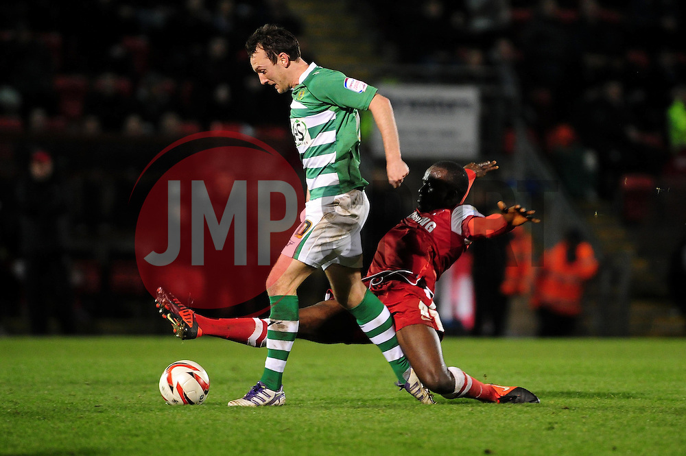 Yeovil Town's Gavin Williams is fouled by Leyton Orient's Anthony Griffith, and as a result receives his first yellow card  - Photo mandatory by-line: Dougie Allward/JMP - Tel: Mobile: 07966 386802 09/01/2013 - SPORT - FOOTBALL - Matchroom Stadium - London -  Leyton Orient v Yeovil Town - Johnstone's Paint Trophy Southern area semi-final.