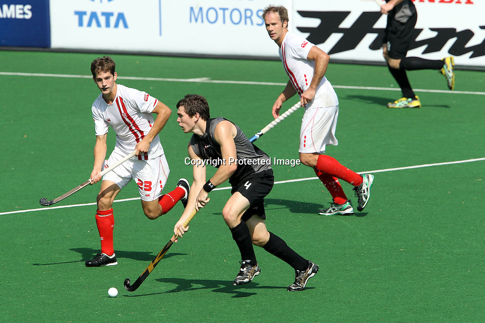Nick Haig attacks for New Zealand during the hockey match between New Zealand and Canada during the XiX Commonwealth Games  held at the MDC Stadium in New Delhi, India on the  10 October 2010<br /> <br /> Photo by:  Ron Gaunt/photosport.co.nz