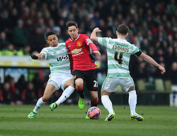 Yeovil Town's Joe Edwards and Yeovil Town's Nathan Ralph tackle Manchester United's Ander Herrera  - Photo mandatory by-line: Joe meredith/JMP - Mobile: 07966 386802 - 04/01/2015 - SPORT - football - Yeovil - Huish Park - Yeovil Town v Manchester United - FA Cup - Third Round