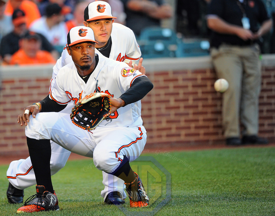 22 August 2016:  Baltimore Orioles center fielder Adam Jones (10) crouches down with third baseman Manny Machado (13) behind him to catch a ball at Orioles Park at Camden Yards in Baltimore, MD.  (Photograph by Mark Goldman/Icon Sportswire)