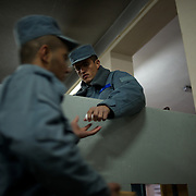 November 14, 2012 - Kabul, Afghanistan: A Afghan National Police (ANP) cadet distribute boiled eggs during breakfast at the Afghan Nacional Police Academy...ANP Academy trains 1250 cadets at the time during a period of four years. Every year, five hundred new recruits are selected, out of more than nine thousand of candidates, to join the academy and other five hundred graduate. Fifteen per cent of the recruits are women. (Paulo Nunes dos Santos)