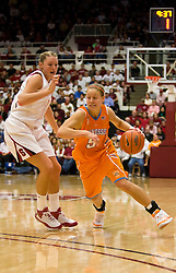 December 19, 2009; Stanford, CA, USA;  Tennessee Lady Volunteers guard/forward Angie Bjorklund (5) is guarded by Stanford Cardinal forward/center Jayne Appel (2) during the second half at Maples Pavilion.  Stanford defeated Tennessee 67-52.