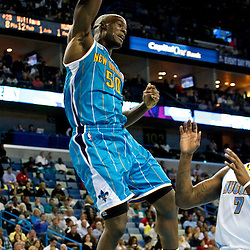 October 29, 2010; New Orleans, LA, USA; New Orleans Hornets center Emeka Okafor (50) dunks against the Denver Nuggets during the fourth quarter at the New Orleans Arena. The Hornets defeated the Nuggets 101-95.  Mandatory Credit: Derick E. Hingle