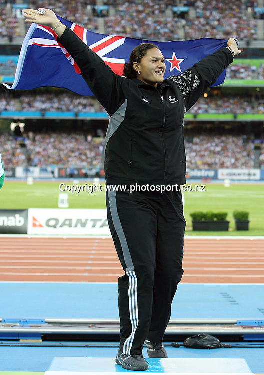 New Zealand shot put athlete Valerie Vili (NZL) walks up on to the podium to receive her gold medal on Day 8 of the XVIII Commonwealth Games at the MCG, Melbourne, Australia on Thursday 23 March, 2006. Photo: Hannah Johnston/PHOTOSPORT