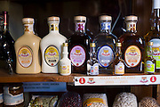 Crema de Orujo and Crema de Cafe local speciality flavoured liqueurs on sale in shop in Potes, Cantabria, Spain
