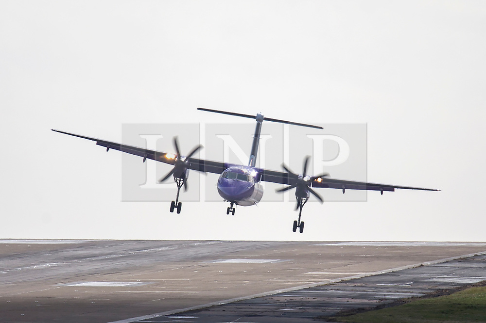 © Licensed to London News Pictures. 04/03/2019. Leeds UK. A Flybe aircraft struggles to land this morning at England's highest airport, Leeds Bradford International as storm Freya continues to batter the UK. Photo credit: Andrew McCaren/LNP