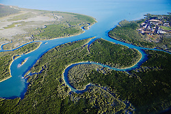 Aerial view of Broome's Chinatown looking over Dampier Creek.  Mangroves line the many inlets and surround the town.