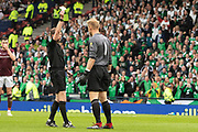 Zdenek Zlamal of Hearts receives a yellow card for delaying the restart of play during the William Hill Scottish Cup Final match between Heart of Midlothian and Celtic at Hampden Park, Glasgow, United Kingdom on 25 May 2019.