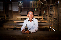 A portrait of Fayda Yaryia, 31, village leader in Khon Kahndone Village, Laos.