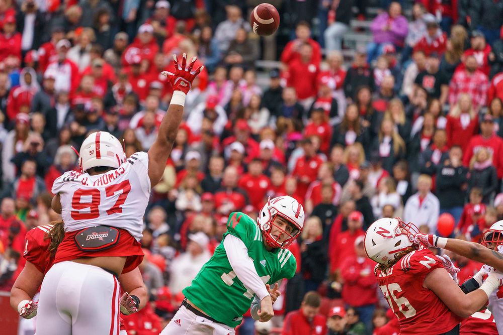 Deontre Thomas #97 tries to bat down a pass by Tristan Gebbia #14 during Nebraska's annual Spring Game at Memorial Stadium in Lincoln, Neb., on April 21, 2018. © Aaron Babcock