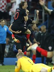 (l-r) Luka Modric of Croatia, Mario Mandzukic of Croatia, goalkeeper Jordan Pickford of England during the 2018 FIFA World Cup Russia Semi Final match between Croatia and England at the Luzhniki Stadium on July 01, 2018 in Moscow, Russia