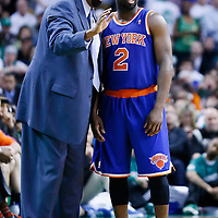 28 April 2013: New York Knicks head coach Mike Woodson talks to New York Knicks point guard Raymond Felton (2) during Boston Celtics 97-90 overtime victory over the New York Knicks during Game Four of the Eastern Conference Quarterfinals of the 2013 NBA Playoffs at the TD Garden, Boston, Massachusetts, USA.