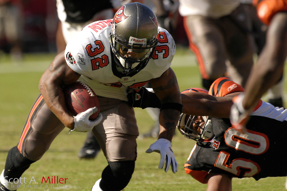 Oct. 15, 2006; Tampa, FL, USA;  Tampa Bay Buccaneers running back (32) Michael Pittman is tackled by Cincinnati Bengals defender (50) Ahmand Brooks in the second half of the Bucs 14-13 win at Raymond James Stadium. ...©2006 Scott A. Miller